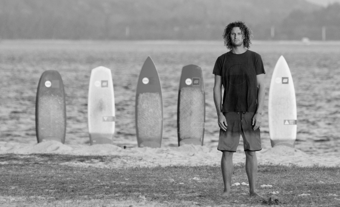 sky standing with surfboards